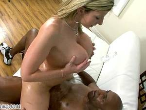 American housewife milking a large piece of black meat
