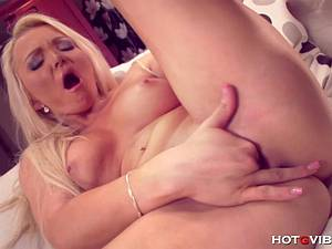 Naughty blonde with huge titties rubs her pussy