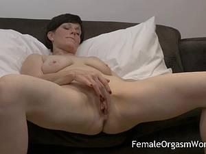 Horny MILF masturbating fleshy pussy to climax
