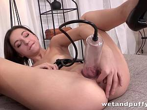 Slender woman with small boobies pumps her pussy